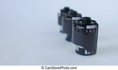 Old 35 mm film in cartridge on a white background. Slider...