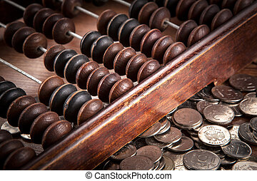 old abacus with russian ruble coins
