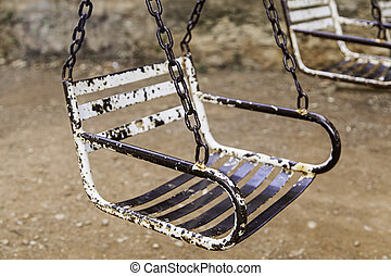Old abandoned and rusty swings