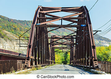 Old abandoned bridge on the river