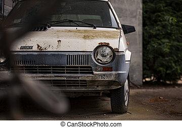VILLANOVA DEL GHEBBO, ITALY 3 MAY 2020: Old abandoned and rusty car exterior detail