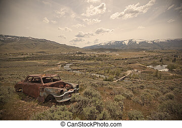 Old abandoned car with bullet holes. Reno Nevada high desert