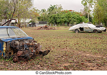 Old Abandoned Cars In A Yard
