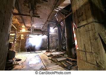 Old abandoned dirty empty scary factory interior