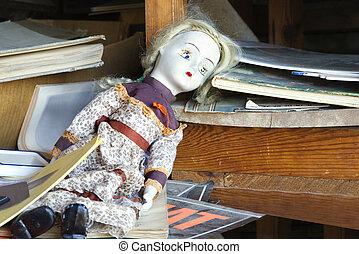 Old abandoned doll on shelf