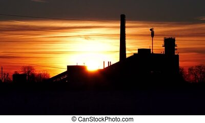 old abandoned factory on the background of the setting sun in winter timelapse video