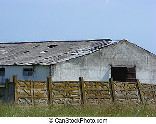 Old abandoned farm on the outskirts of a city in romania