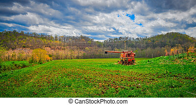 Old Abandoned Harvester in a Field