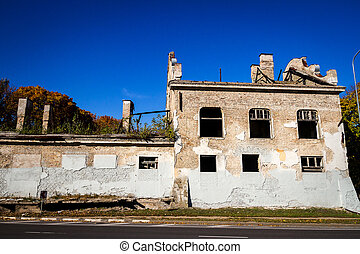 Old abandoned house by the road