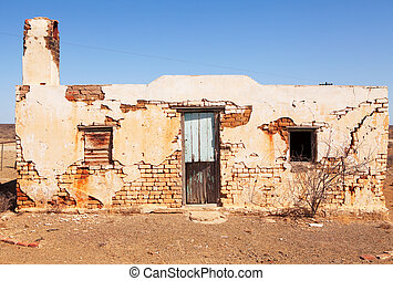 Old single abandoned house in desert area