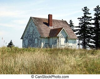 Old abandoned house - Old abandoned boarded up house, on...