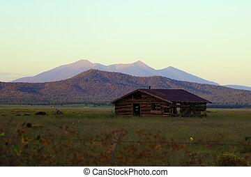 Old abandoned house on a background of mountains, Arizona