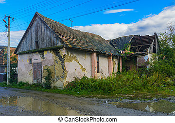 Old abandoned house on the edge of the village