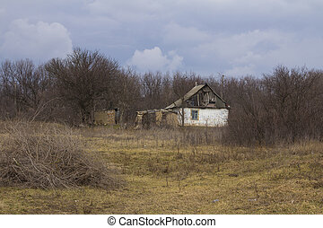 Old abandoned house on the outskirts of the village