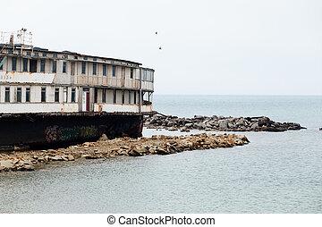 Old abandoned ship on the Black Sea coast in the Crimea