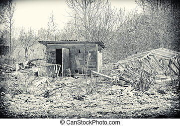 Old abandoned small house. Black and white.