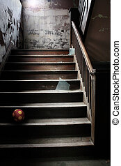 Old abandoned stairs with broken glass and a ball