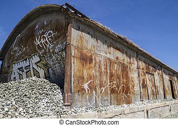 old abandoned train station, rusty iron walls