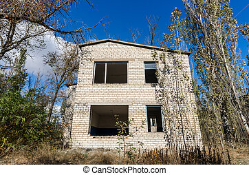 old abandoned wooden village house in Ukraine in autumn