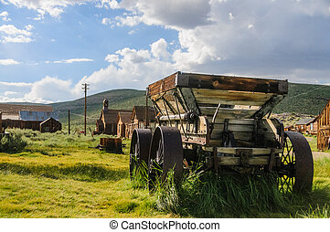 An old wooden wagon with rusty iron wheels in the the American Ghost town of Bodie.