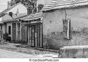 Old abandoned weathered houses, black & white