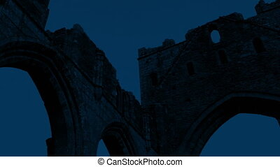 Old Abbey Ruins At Night - Panning shot of ancient abbey...