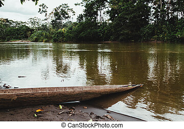old aboriginal boat on a river in the amazon