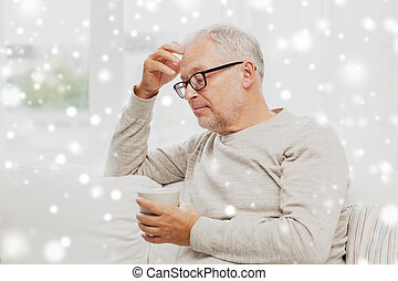 senior man with cup of tea at home