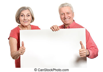 Old age couple holding blank banner ad against white ...