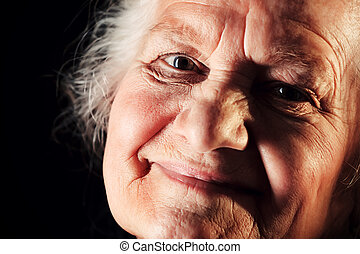 old age happiness - Portrait of a happy senior woman smiling...