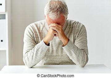 close up of senior man thinking