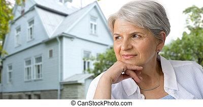 portrait of pensive senior woman