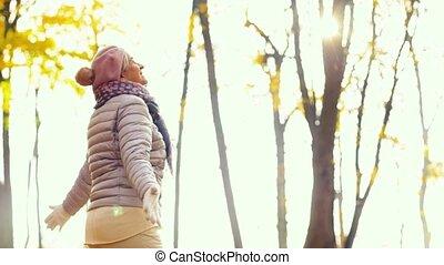 happy senior woman enjoying beautiful autumn - old age,...