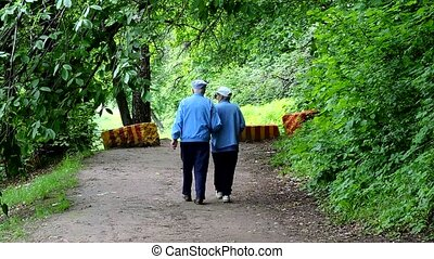 old age, retirement - happy senior couple walking at summer city park