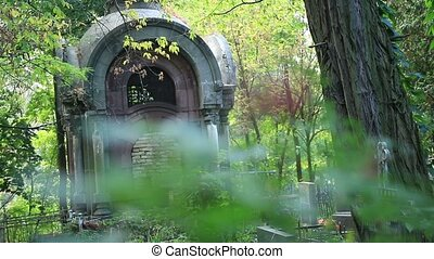 Old aged grave crypt in cemetery