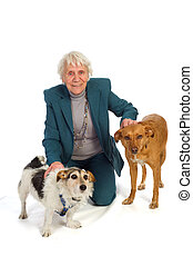 Old aged woman with pets - Old aged woman with two dogs in...