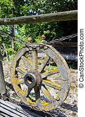 old aged wooden cart wheel in farm