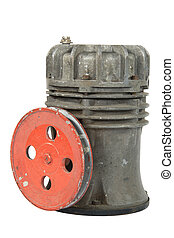 Old air compressor with pulley (isolated)
