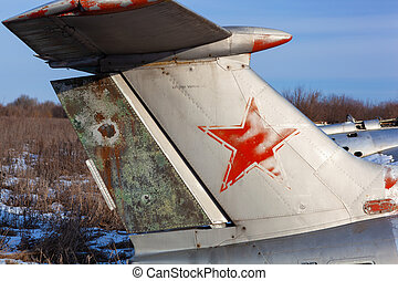 Old aircraft tail with USSR star. - Close up of old aircraft...