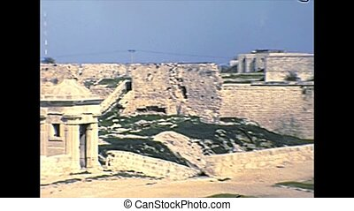 old Akko walls with Acre city wall Watchtowers, Historical landmark, in Haifa Bay. Archival footage in the 1970s of Israel. Acre town is known to locals as Akko.