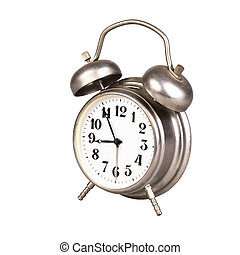 Old alarm clock on a white background