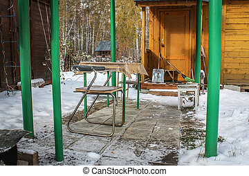 Old alcove in the yard Russian country house