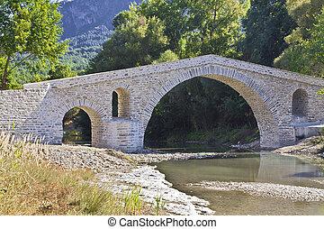 Old alike stone bridge at Greece