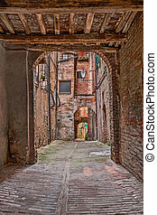 old alley in Siena, Tuscany, Italy