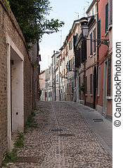 Old alley in the city centre of Ferrara Italy