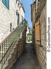 Old alley in Trogir in Croatia