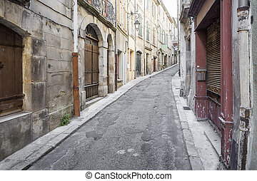 Old alleyway in the small town of Joyeuse, France
