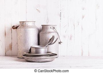 Old aluminium utensils on the shabby chic kitchen