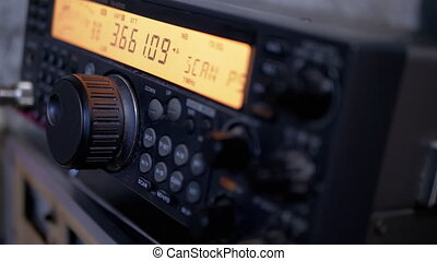 Old Amateur Stationary Radio Station. 4K. Manual tuning of signal at different frequencies. Control panel with black buttons, orange dial. Frequency scan. Radiovesch over long distances. Close-Up.