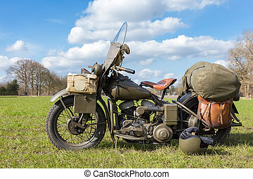 Old american military motorcycle parked on grass